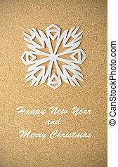 Christmas postcard with true paper snowflake