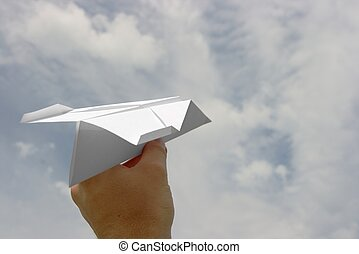 Paper Plane - Paper plane in a hand against cloudy sky