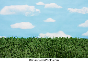 Grass and sky background - Green grass with a blue sky...