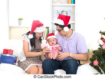 Asian chinese young family celebrating christmas with baby...