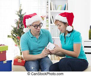 asian couple lifestyle christmas celebration gift sharing