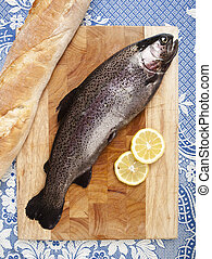 freshly caught trout fishing - freshly caught trout, served...