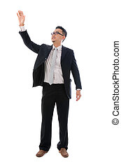 Business man touching an imaginary screen or button on white background