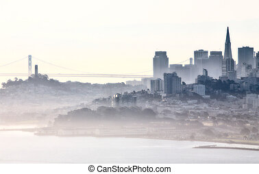 San Fransisco Skyline fog rolling in morning sunrise