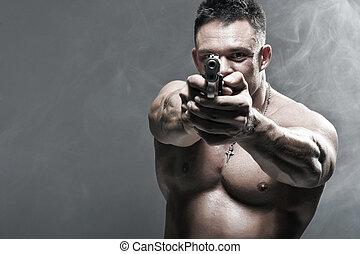 Serious Male Holding a Gun