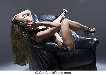 woman in lingerie with headphones