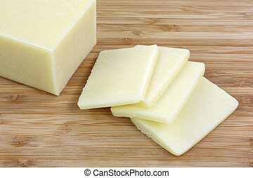Reduced Fat Cheese Slices - A close view of a block of...