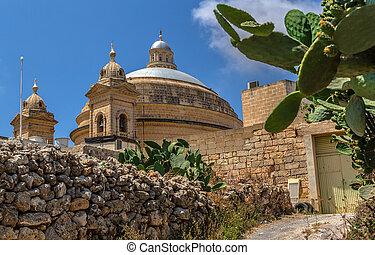 Mgarr Church Behind the Wall - Mgarr church in Malta behind...
