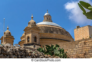 Mgarr Church Across the Street - Mgarr church in Malta seen...