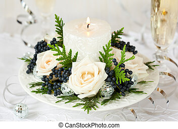 Christmas table decoration with roses,winter berries and...