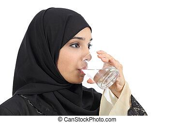 Arab woman drinking water from a glass isolated on a white...