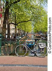 bike on canal ring bridge, Amsterdam - bike on a bridge,...