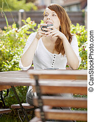 Attractive redhead woman daydreaming - Attractive redhead...