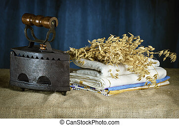 Old Iron And Bunch Of Oats On The Table