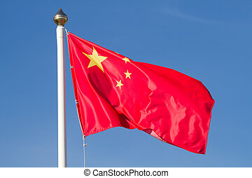 Chinese national flag with blue sky