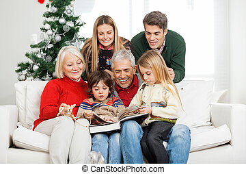 Family Reading Book Together In House - Happy...