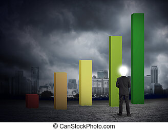 businessman looking growth chart