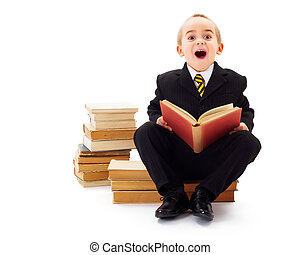 Surprised Child - Surprised little kid reading a story from...