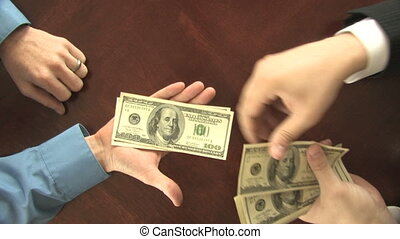 Paying Cash, Top View - A man%u2019s hand transfers hundred...