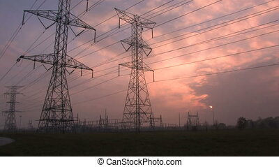 Power Substation - High voltage transmission lines in front...
