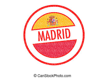 MADRID - Passport-style MADRID rubber stamp over a white...