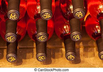 Vineyard - Bottles of rose wine stacked in display in wine...