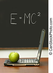 Desk with laptop and green apple