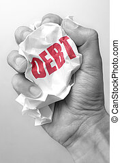 Debt reduction - Hand squeezing a crumpled piece of paper...