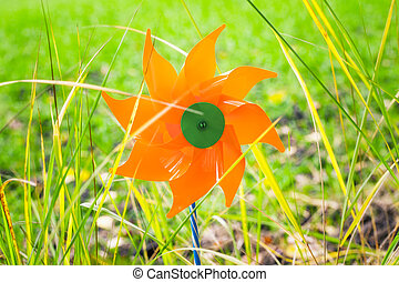 Toy windmill in the grass
