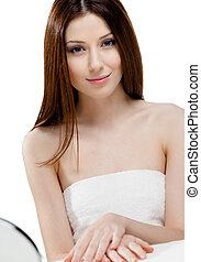 Portrait of pretty woman in towel