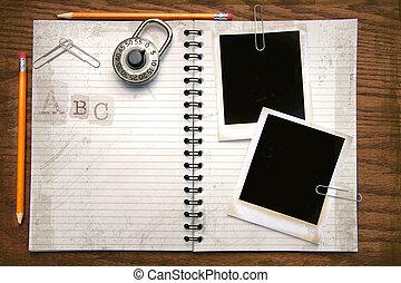 White copy book, pencils and polaroids