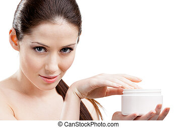 Pretty woman starting to apply face cream - Woman holding...