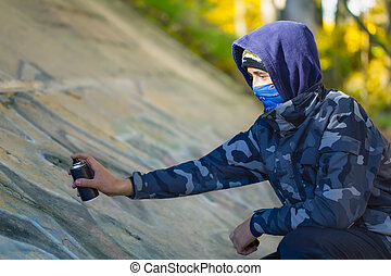 Teenager with color spray can
