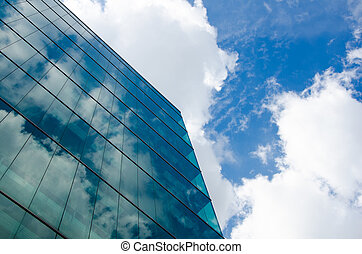 skyscraper against sky and building glass background