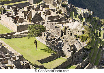 Machu Picchu - Close up view of some of the buildings of...