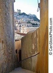 Narrow street in Ragusa Sicily - Ragusa Sicily built on a...