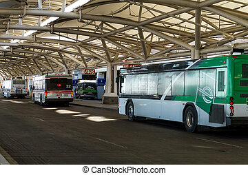 Denver International Airport - Car rental buses drop off and...