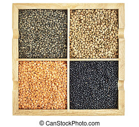 red, green, black and French lentils in a square wooden box...