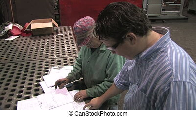 Reviewing Blueprints in Factory 3 - A factory worker goes...