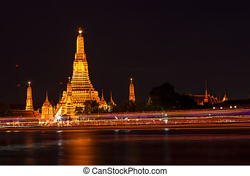 Wat Arun in the evening Lights that adorn the temple And...