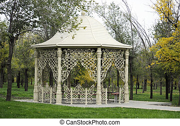 Fancy arbor - Beautiful arbor in autumn park surrounded by...