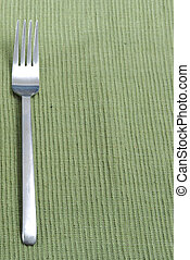 fork with room for text - fork on place mat with copy space...