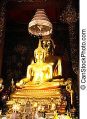 Golden buddha statue beautiful in the church of Wat...