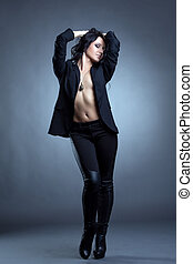Beddable woman posing topless in stylish clothes - Image of...