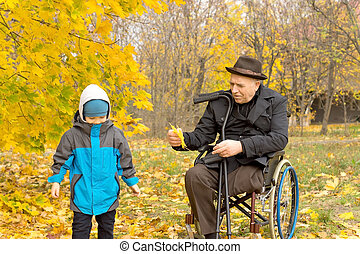 Disabled grandfather playing with his grandson