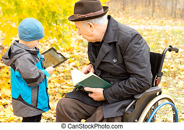 Grandfather and grandson enjoying leisure time - Disabled...