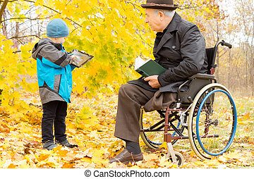 Handicapped elder man with one leg amputated sitting in a...