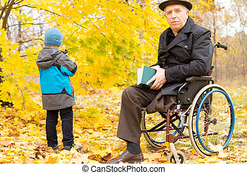 Handicapped senior man and child - Handicapped senior man...