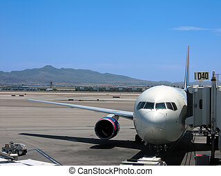 Airplane at gate - Airplane parked at gate at McCarran...