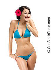 Woman wearing bikini and flower in hair - Portrait of woman...